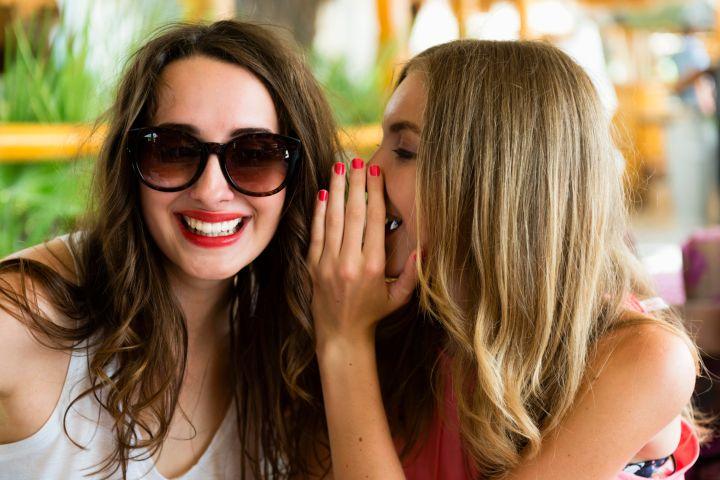 Beautiful Women Sharing Secrets at Beach Coctail Club, Europe