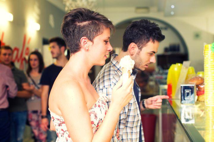 Couple buy an ice cream cone