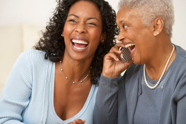 Mother and Daughter Telephoning Together