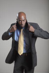 African American businessman adjusting collar of jacket