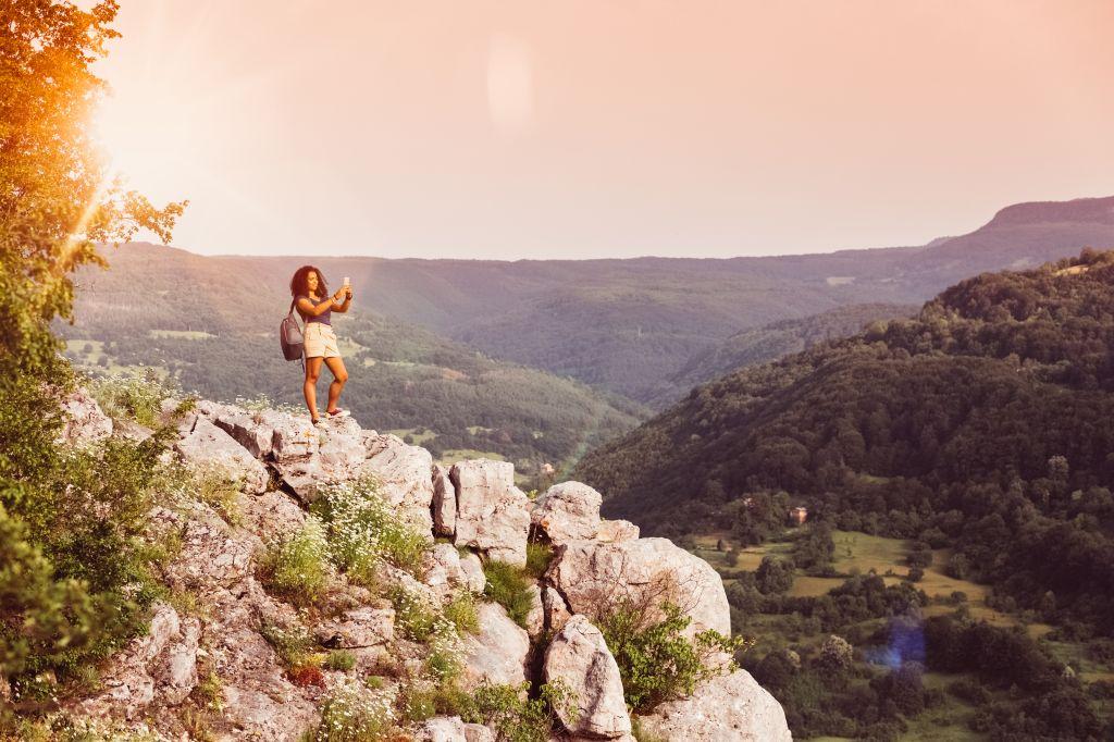 Tourist on the mountain top