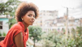 portrait of beautiful young cuban woman on balcony in Havanna