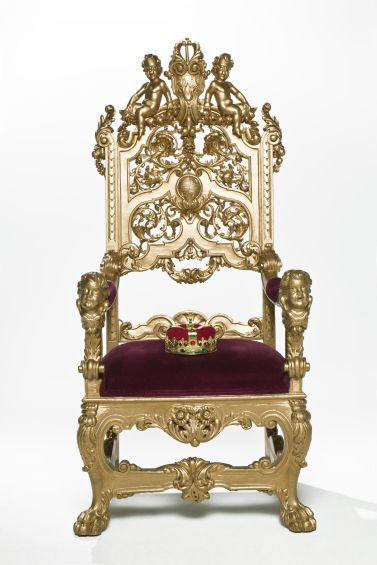 Kings crown sitting on throne