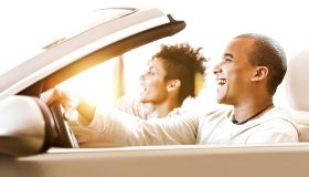 African-American couple in convertible car.