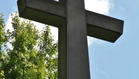 Looking up at an outdoor stone cross