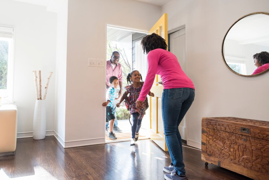 Mother answering the door to her family