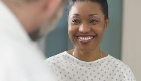 Woman patient smiling at doctor