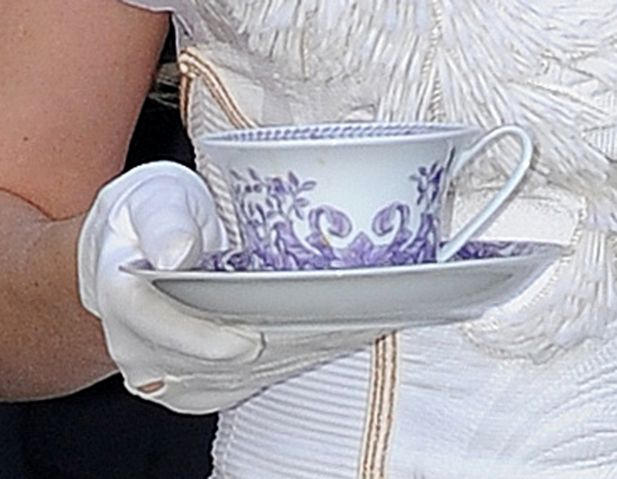 White dress, long hair, tinted sunglasses, cup of tea, cup and saucer, poppy