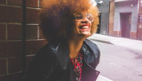 Woman with Afro Smiling