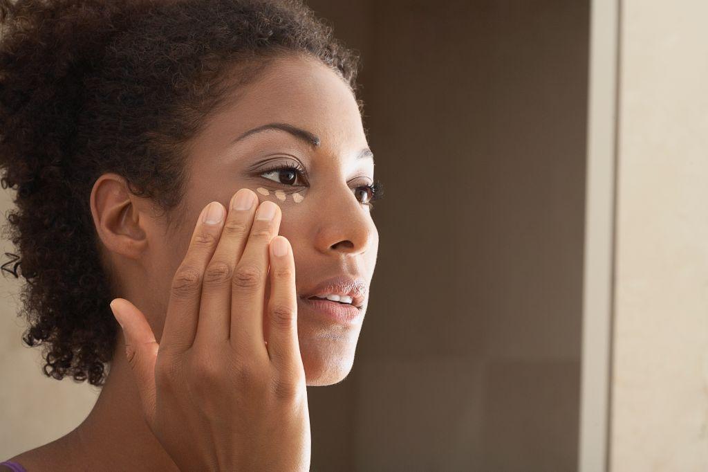 Woman Applying Makeup - stock photo